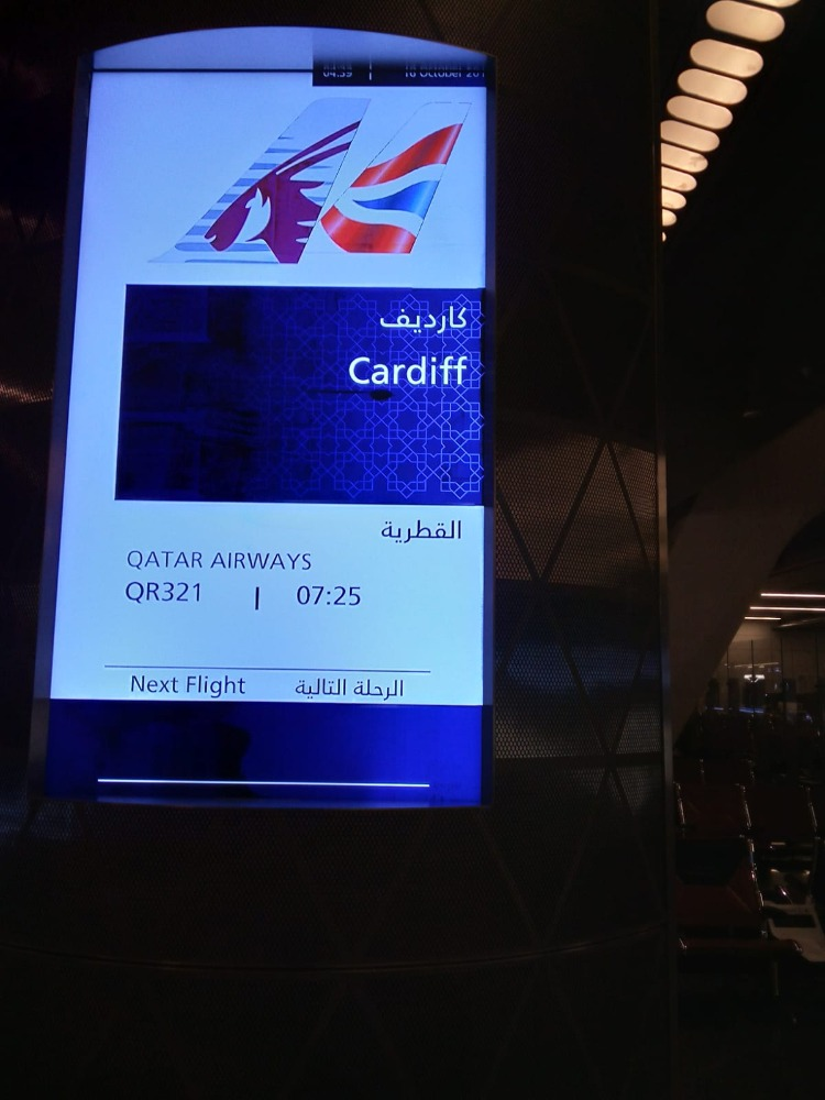 Departure board at Doha airport . How to spell Cardiff in Arabic