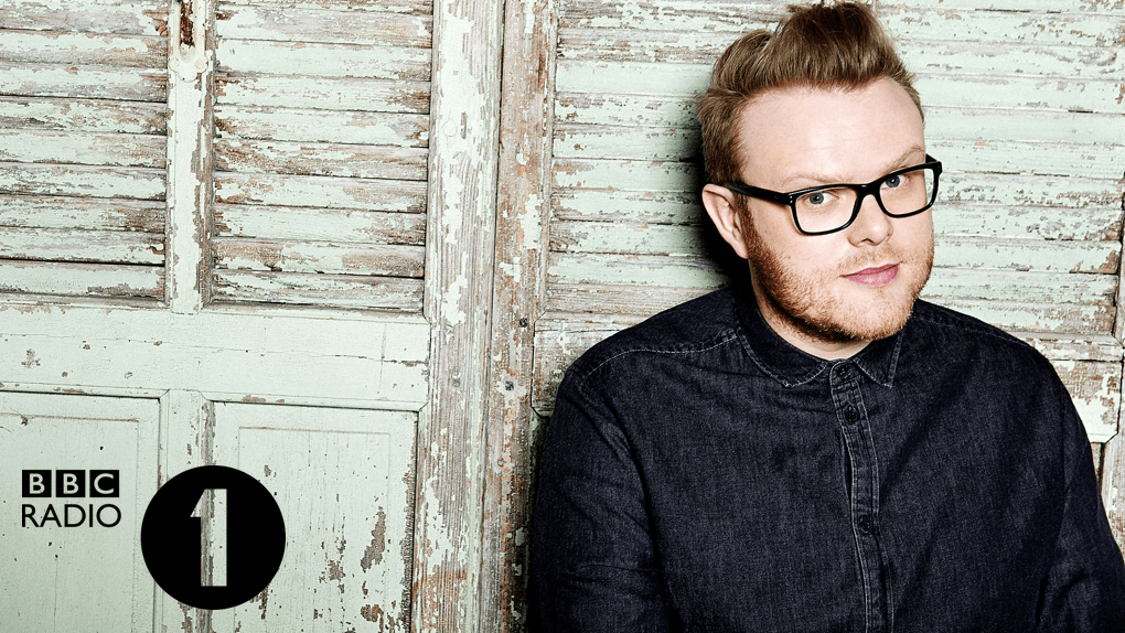 Huw Stephens with Radio 1 logo