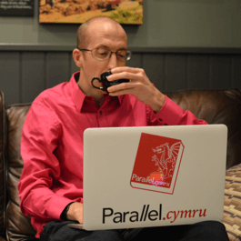 Parallel.cymru's Neil designing over coffee
