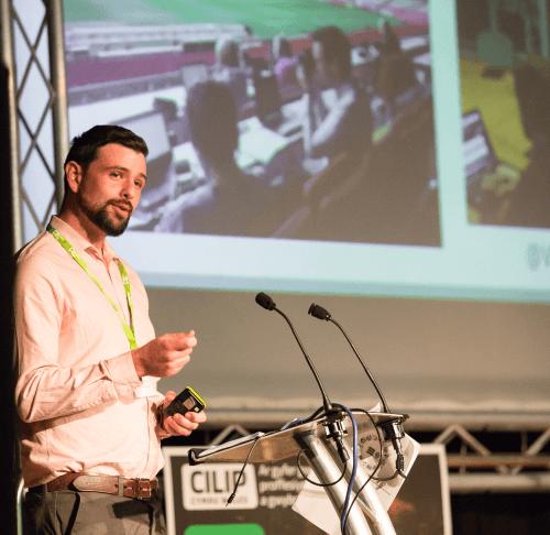 Wicipedia's Jason Evans presenting at a CILIP conference